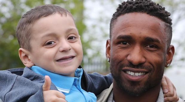 Bradley Lowery with Jermain Defoe (Owen Humphreys/PA)
