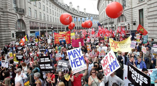 Protesters march down Regent Street (Yui Mok/PA)