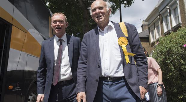 Vince Cable, right, says Tim Farron struggled to mix his personal faith with public position (Victoria Jones/PA)