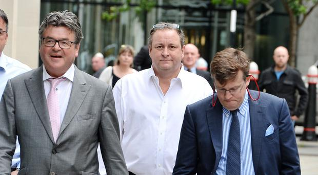 Mike Ashley Newcastle United owner and sportswear firm boss Mike Ashley (centre) arrives at the High Court in London (John Stillwell/PA)