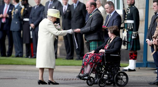 Queen Elizabeth II receives the keys from Lord Provost Frank Ross during the Ceremony of the Keys at the Palace of Holyroodhouse in Edinburgh (Jane Barlow/PA)