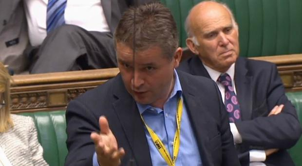 SNP MP Angus Brendan MacNeil took advantage on new rules which mean men no longer need to wear ties in the House of Commons (PA)