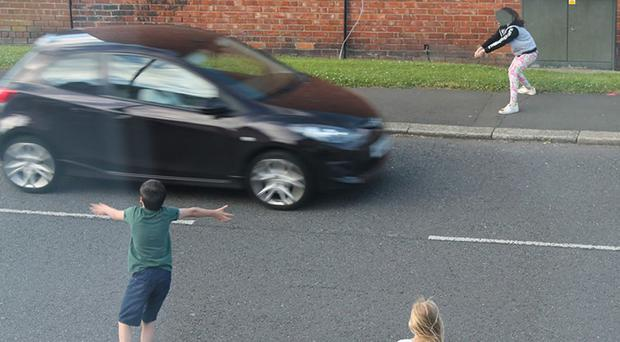 Young children playing chicken in a busy road in Washington (Northumbria Police/PA)