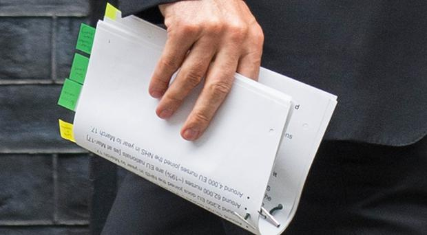 Health Secretary Jeremy Hunt with the briefing notes he was expected to use in response to warnings EU nationals would be