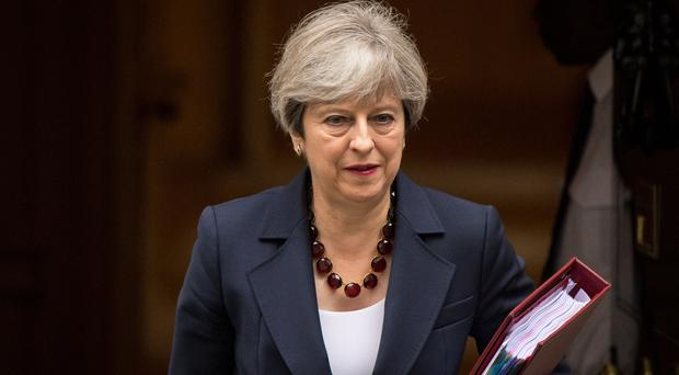 Theresa May's popularity among Tory members has fallen dramatically, according to a survey from an influential Conservative website (Dominic Lipinski/PA)