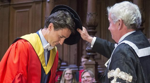 Mr Trudeau received an honorary degree from Edinburgh University (Ryan Remiorz/The Canadian Press via AP)