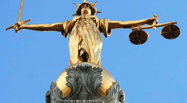 A 61-year-old Belfast man has appeared before the High Court