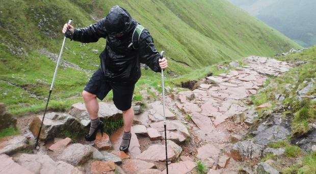 Ben Conway ditched his hiking boots to climb up Britain's highest peak in a pair of five-inch heels (Callum MacKenzie Allen/PA)