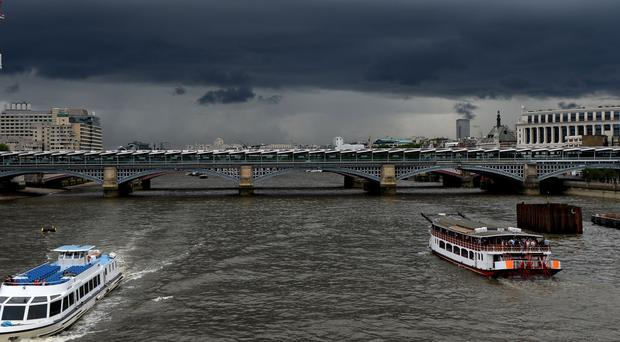 Storm clouds gather over London (Andrew Matthews/PA)