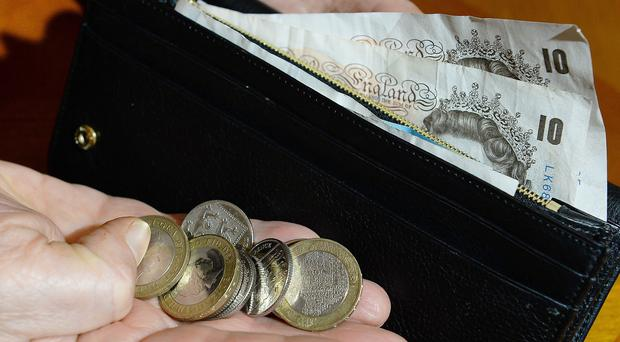 Household disposable income per head dropped by 2% year-on-year (John Stillwell/PA)