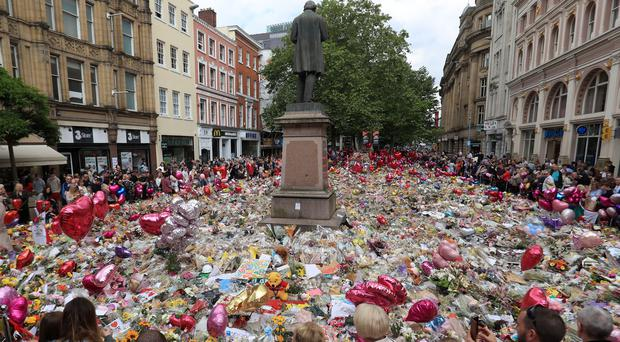 Floral tributes to those killed in the bombing, in St Ann's Square, Manchester (Danny Lawson/PA)