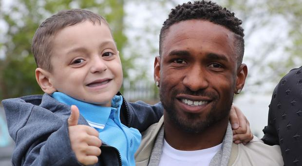Former Sunderland striker Jermain Defoe, now with Bournemouth, holds Bradley Lowery (Owen Humphreys/PA)