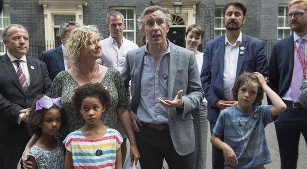 Steve Coogan talks to the media after delivering messages of love from more than 60 schools (Victoria Jones/PA)