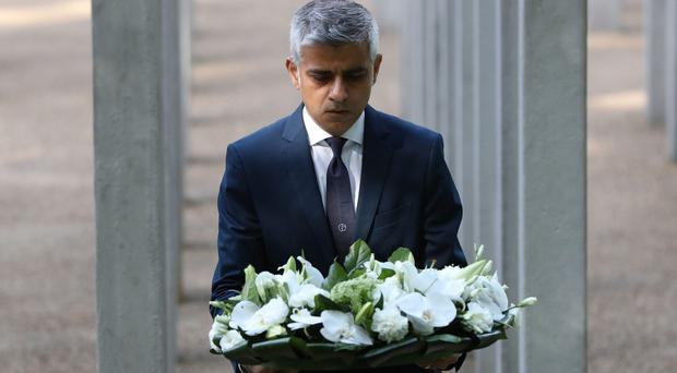 Mayor of London Sadiq Khan lays flowers during a service for the 12th anniversary of 7/7 attacks (Jonathan Bradley/PA)