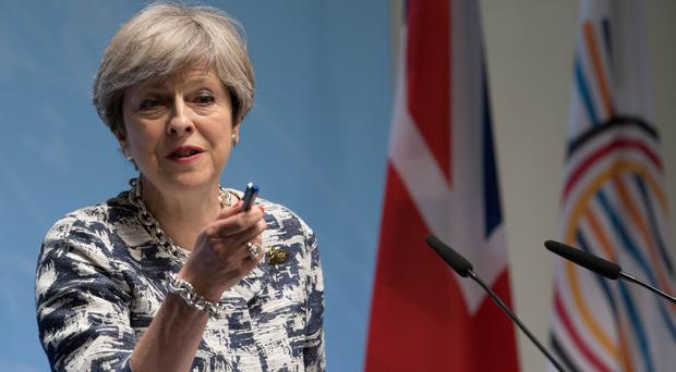 Prime Minister Theresa May during her news conference as she attends the G20 summit in Hamburg (Stefan Rousseau/PA)