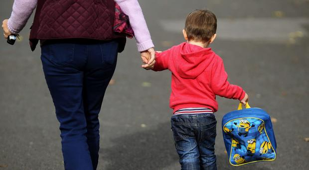 There has been an increasing reliance on grandparents to help with childcare (Niall Carson/PA)