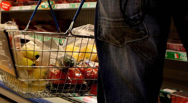 A person shopping in a supermarket (Julien Behal/PA Wire/PA Images)