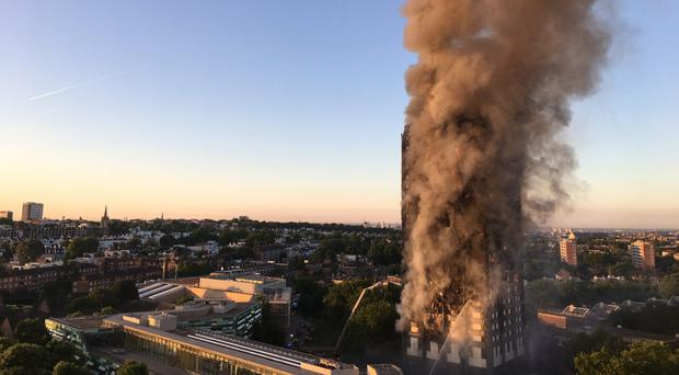 Smoke rises from Grenfell Tower (Natalie Oxford/PA)