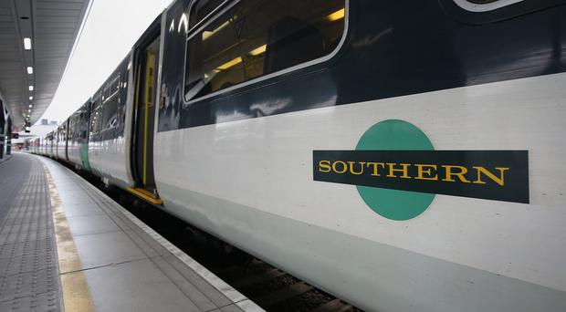 Transport Secretary Chris Grayling has told Sourthern Railway to fund £13.4m package of improvements (Philip Toscano/PA)