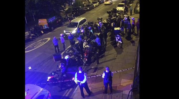 Police said that five linked acid attacks by men on mopeds in London have left several people injured (Sarah Cobbold via AP)