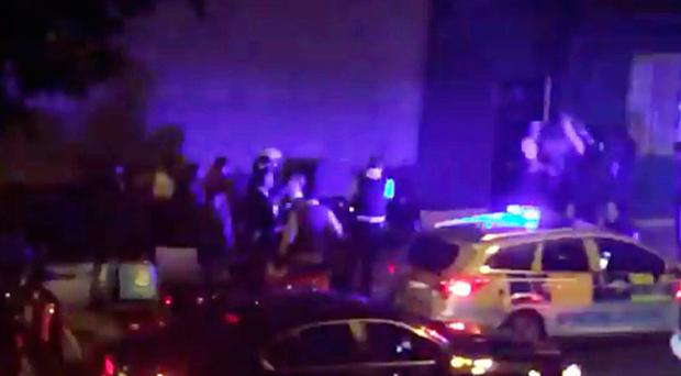 An image taken from video footage of police at the scene of the acid attacks in London on Thursday night