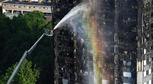 Firefighters at the scene at Grenfell Tower (Victoria Jones/PA)