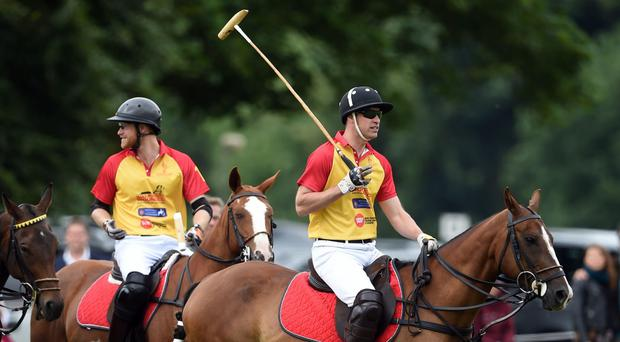 Prince Harry and The Duke of Cambridge, right, enjoy a game of polo (Joe Giddens/PA)