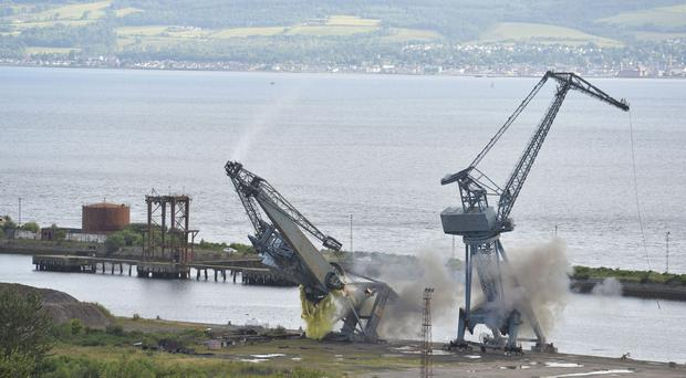 The Inchgreen cranes are demolished by a controlled explosion (John Linton/PA)