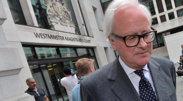 Former Barclays chief executive John Varley leaves Westminster Magistrates' Court (Dominic Lipinski/PA)