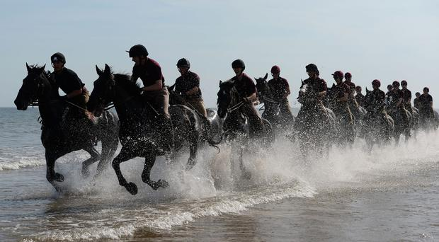 Household cavalry troops on Holkham Beach (Joe Giddens/PA)