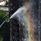 Firefighters spraying Grenfell Tower (Victoria Jones/PA)
