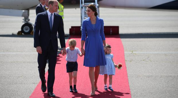 The Duke and Duchess of Cambridge with Prince George and Princess Charlotte arriving at Berlin (Jane Barlow/PA)