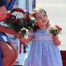 Princess Charlotte holds a bouquet as she lands in Berlin (Jane Barlow/PA)