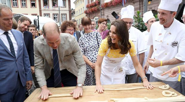 The Duke and Duchess of Cambridge attempt to make pretzels (Chris Jackson/PA Wire/PA Images)
