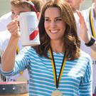 The Duchess of Cambridge holds a beer stein after losing the rowing race (Dominic Lipinski/PA Wire/PA Images)