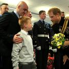 Prince Harry meets Jordan Brown and his son Sam (Stephen Pond/PA)
