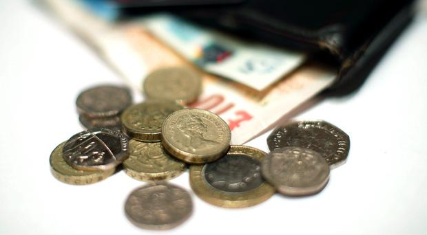 Spending is down in the UK (Yui Mok/PA)