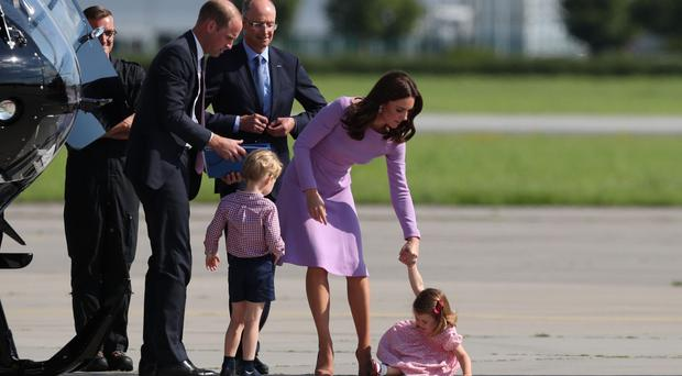 Princess Charlotte falls over as she, Prince George and their parents, the Duke and Duchess of Cambridge, visit Airbus in Hamburg, Germany.