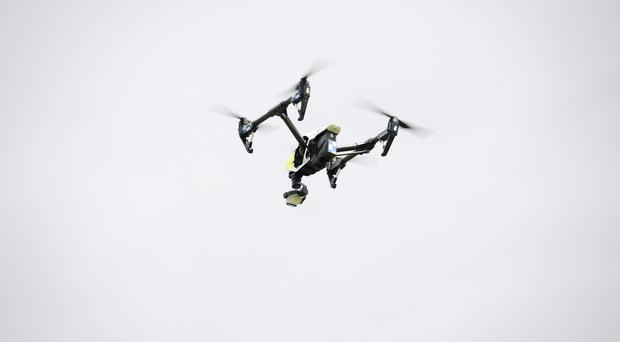 Drones weighing 250g or more will have to be registered (Ben Birchall/PA)