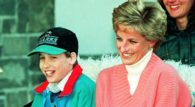 Prince William with his mother. (Martin Keene/PA)
