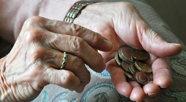 The state pension age for men and women will be equalised at 65 at the end of 2018 before rising to 66 in 2020 and 67 in 2028 (Kirsty O'Connor/PA)