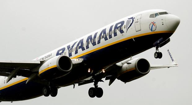 Ryanair posted a 13% rise in revenue but has issued a warning (PA)