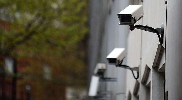 Police are investigating reports of a security camera pointed at the house (Clive Gee/PA)
