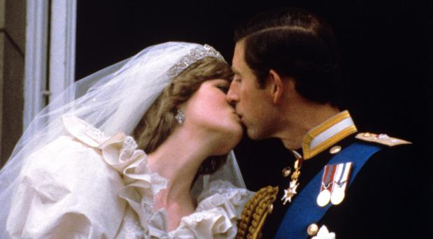 Diana with the Prince of Wales on their wedding day (PA)