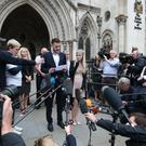 Chris Gard and Connie Yates speak to the media outside the High Court (Jonathan Brady/PA)