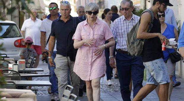 Theresa May and husband Philip are currently on holiday in northern Italy (Antonio Calanni/PA)