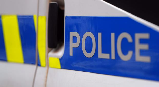 Two men taken to hospital after suspected noxious substance attack
