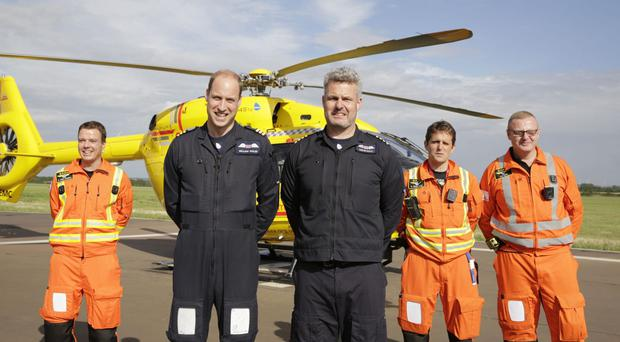 The Duke of Cambridge (2nd left) starts his final shift with the East Anglian Air Ambulance (Heathcliff O'Malley/The Daily Telegraph)
