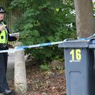 Police at the scene where armed officers shot a man and another was arrested after an incident in Hereford Close, Frankley, Birmingham (Aaron Chown/PA)