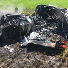 Remains of the car after it crashed off the M1 motorway (South Yorkshire Police/PA)